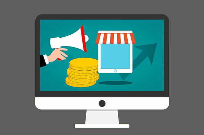hand holding a megaphone with gold coins piled up and an arrow with a retail awning over a tablet
